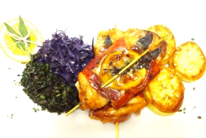 Lemon Herb Chicken with fondant Potatoes and sauted kale and Red Cabbage