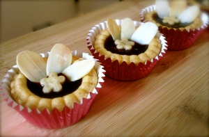 Raspberry Tarts with Almond Petals